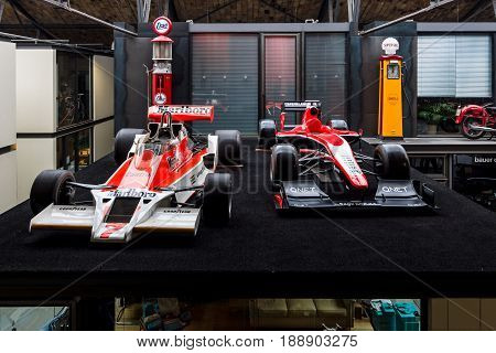 BERLIN - MAY 13 2017: Formula One racing cars McLaren M26 (1976) and Marussia MR02 (2013). Exhibition
