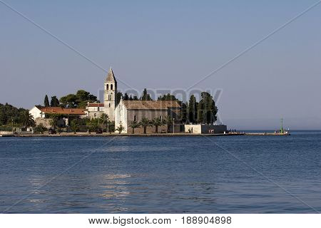 Prirovo a low peninsula in Vis, Croatia with Franciscan monastery built in the 16th century.