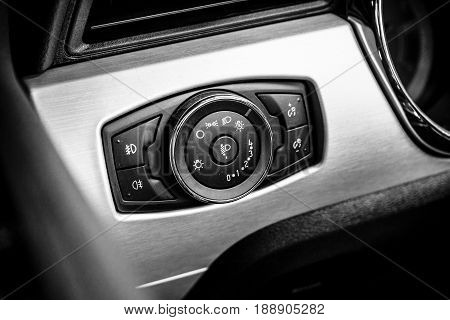 BERLIN - MAY 13 2017: Control buttons of the headlamps of a pony car Ford Mustang 5.0 V8 Convertible 2016. he exhibition
