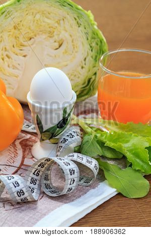 Pepper, Egg, Cabbage, Salad, Ruler And Multivitamin Juice In Glass On The Table