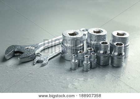 Hand sockets and spanners on light background