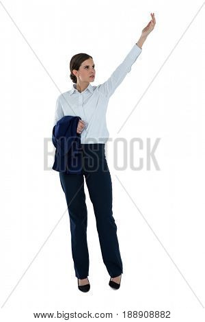 Businesswoman pretending to hold an invisible object against white background