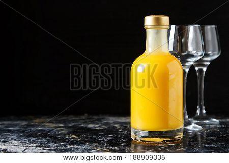 Traditional Italian Yellow Egg Liquor, Bombardino. Dark Backgrou