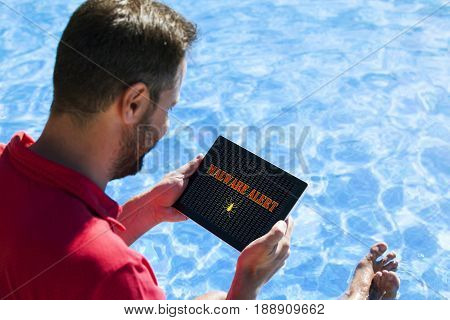 Man holding tablet with malware alert notification in the scree
