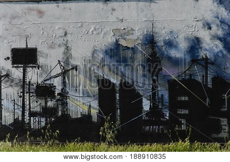 View of a mural with a gloomy industrial landscape