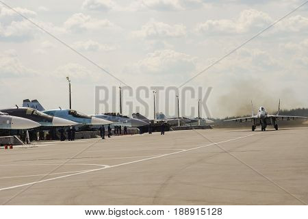 a jet fighter on take-off taxiing to the runway for take-off focus on the back of the plane Russia Zhukovsky air show