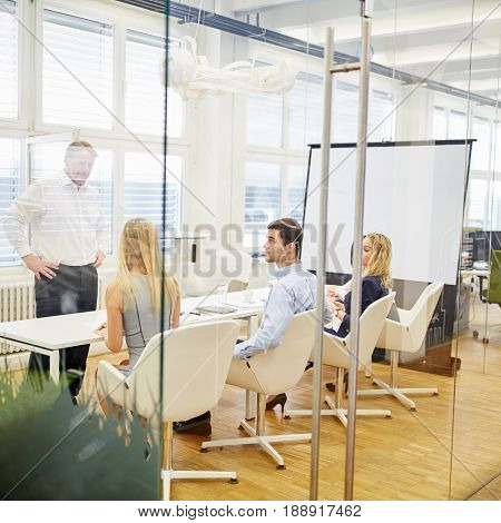 Business team and consultant in a workshop in a conference room