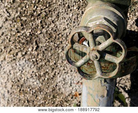 Rusty Faucet Of An Abandoned Garden