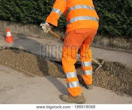 Worker With High Visibility Clothing While Working On A Road Con