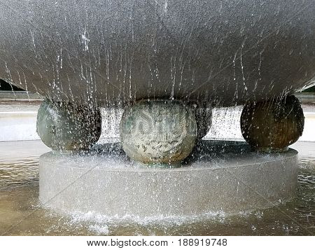 water fountain with water dripping over the side
