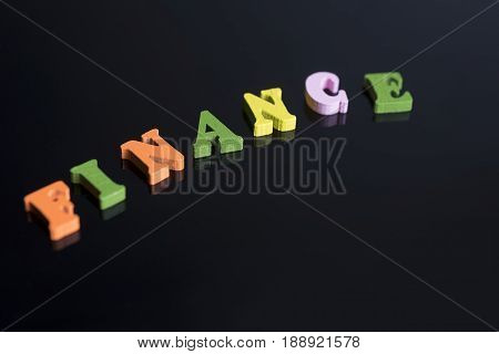 The Word Finance On A Black Background.