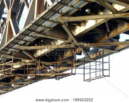 metal construction of old railway bridge with scaffolding for maintenance under