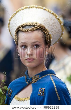 Asti, Italy - September 19, 2010: Young Medieval Princess, during the historic parade of the Palio of Asti in Piedmont, Italy. Young damadel Middle Ages at the Palio