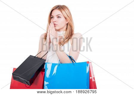 Female Shopper With Paper Bags Holding Hands Clasped