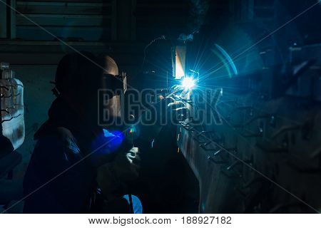 Industrial welder wear safety protective mask welding fabricated construction in factory Welding process by Shielded Metal Arc Welding (SMAW) or Stick Welding.