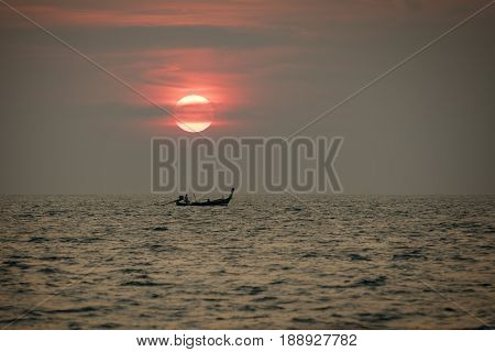sunset and long tail boat phuket thailand