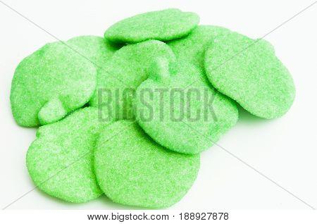 Delicious Green Apple Gummies on white background