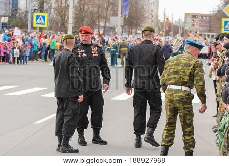 Kirishi, Russia - 9 May, Group in black uniform, 9 May, 2017. Preparation and conduct of the action Immortal regiment in small cities of Russia.