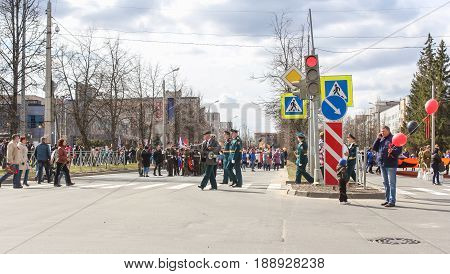 Kirishi, Russia - 9 May, Building a column of people on the avenue., 9 May, 2017. Preparation and conduct of the action Immortal regiment in small cities of Russia.