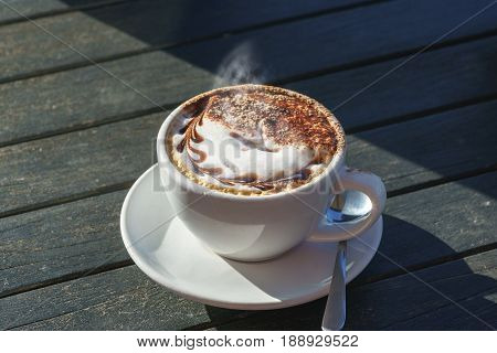 Hot Caffè mocha or mocaccino on wooden table