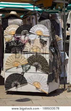 BURANO, ITALY - MAY 23, 2017: Different kinds of lace fans on sale in a street shop at Burano island, Venice, Italy