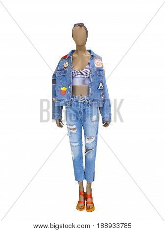 Full-length female mannequin dressed in jeans suit. Isolated on white background. No brand names or copyright objects.