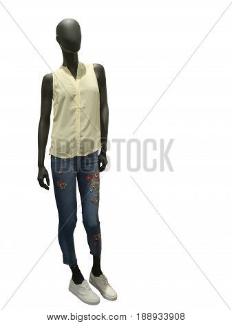 Full-length female mannequin dressed in fashionable clothes. Isolated on white background. No brand names or copyright objects.