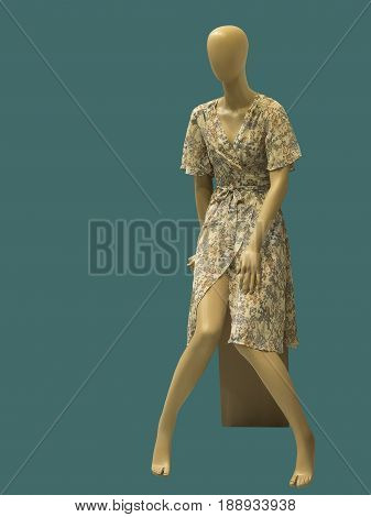 Sitting female mannequin isolated on green background. No brand names or copyright objects.