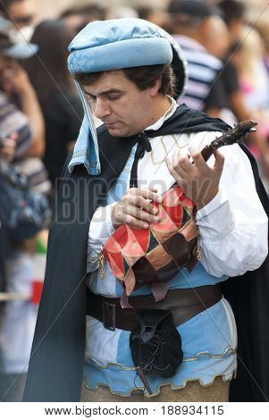 Asti, Italy - September 19, 2010: Medieval young man playing the old guitar, lute in the historic Medieval parade of the Palio of Asti in Piedmont, Italy.