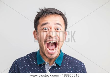 Portrait Of Extremely Angry Asian Man Face