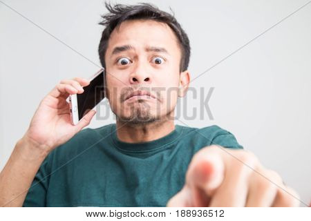 Furious Man Talking On Phone On White Background