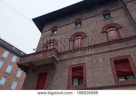 The view of facade of typical building in Bologna. Emilia Romagna Italy.