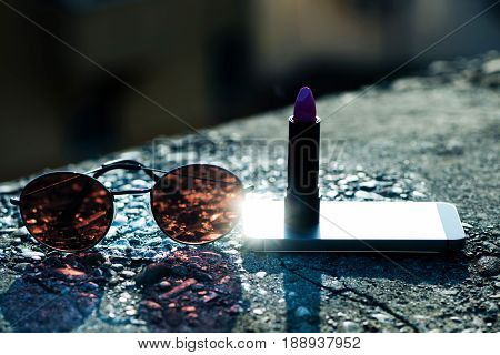 Fashion Sunglasses, Mobile Phone And Lipstick In Tube