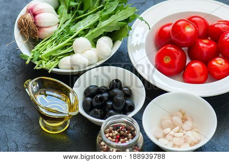 Ingredients For Healthy Salad. Tomatoes, Rucola (eruca Sativa), Spring Onion, Mozzarella, Olives, Ga