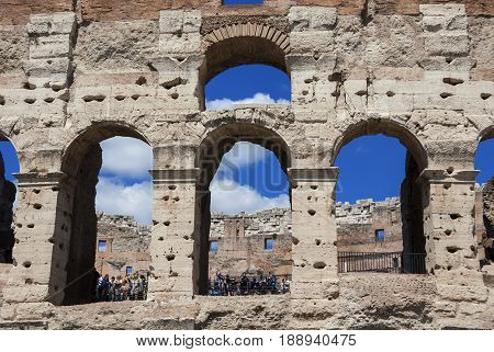 ROME, ITALY - APRIL 23: Tourists visiting Coliseum monumental arcades APRIL 23, 2017 in Rome, Italy