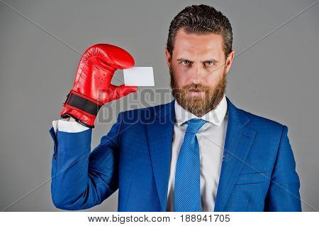 Man Holding Credit Card In Business Suit, Red Boxing Glove