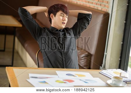 Portrait Of Tired Young Businessman Stretch Oneself