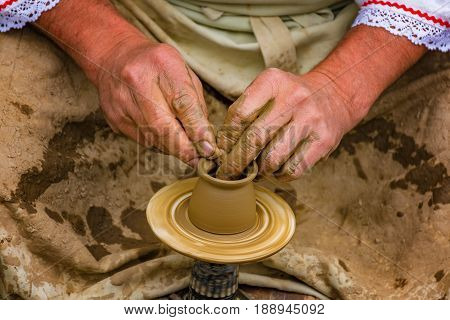 Pottery making on a pottery wheel - folk art