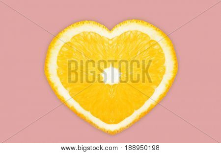 Heart shaped orange on color background. Superfood concept