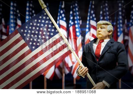 Caricature of United States President Donald Trump waving US flag - action figure toy