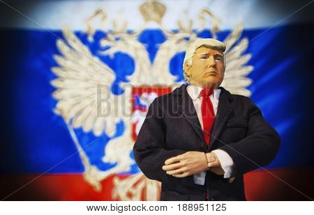 Caricature of United States President Donald Trump standing in front of a Russian Flag - Russian interference concept - conspiracy and controversy