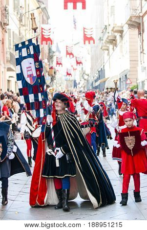 Asti, Italy - September 19, 2010: the historic Medieval parade of the Palio of Asti in Piedmont, Italy. Parade of a prince with banner representing the contrada, Palio in Italy
