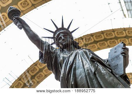 Paris, France, March 28 2017: A bronze replica of the Statue of Liberty by French sculptor Bartholdi stands in the Orsay museum, Paris, France