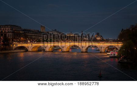 Paris, France, March 28 2017: view of Pont Neuf in Paris on March 7, 2013. Pont Neuf is the oldest standing bridge across the river Seine and first stone in bridge construction was laid in 1578
