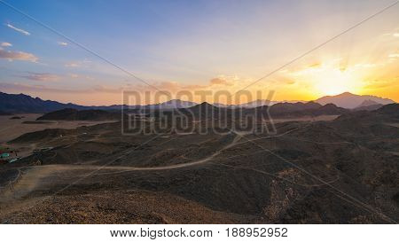 Wonderful landscapeArabian desert of stone Egypt with mountains at sunset.To the left of the desert nomad huts