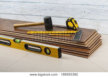 Tools for laying laminate flooring. Copy space for text.