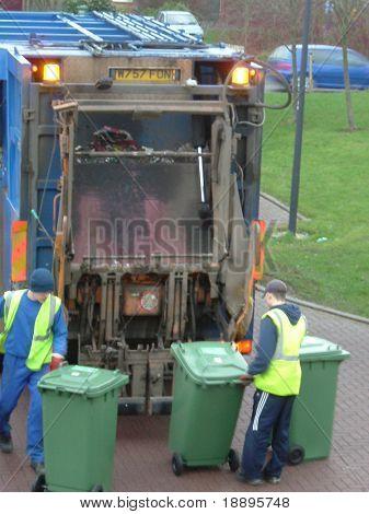 Men emptying trash cans