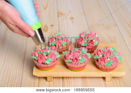 Cupcakes With Cream On Wooden Background