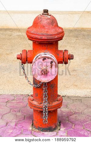 1904 fire hydrant on the building floor. Old and rusty vintage fire hydrant prepare to provide a powerful flow of water for firefighter.