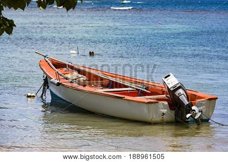Colored small boats on Antilles sea with blue sea.